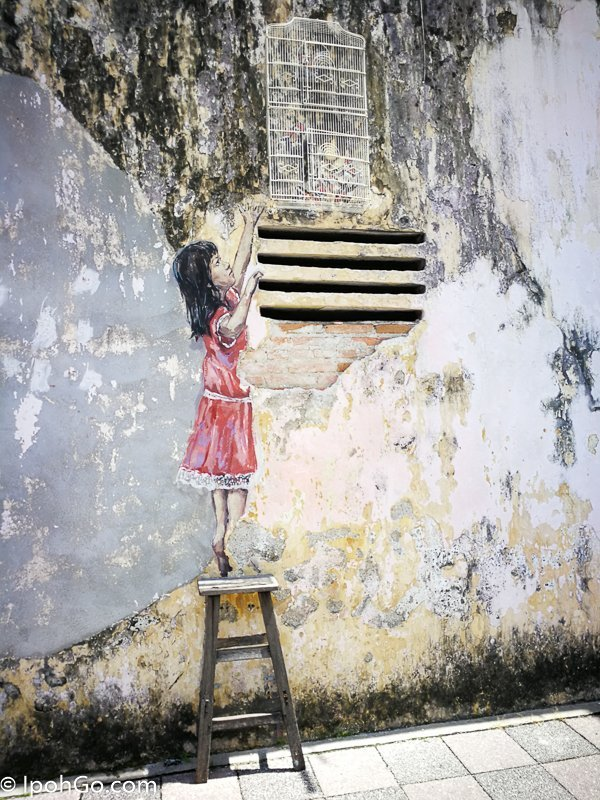 Girl and Birdcage Ipoh Mural Arts Trail